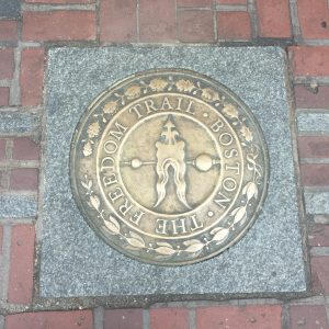 gold crest of the freedom trail in boston