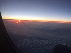 view of sunset surrounded by clouds