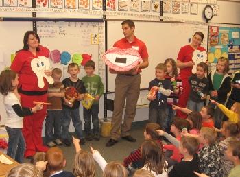 dental team teaching young children