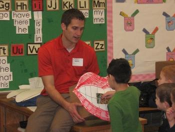 young Dr. Argyle teaching children