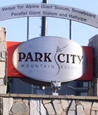 silver and red sign of park city resort