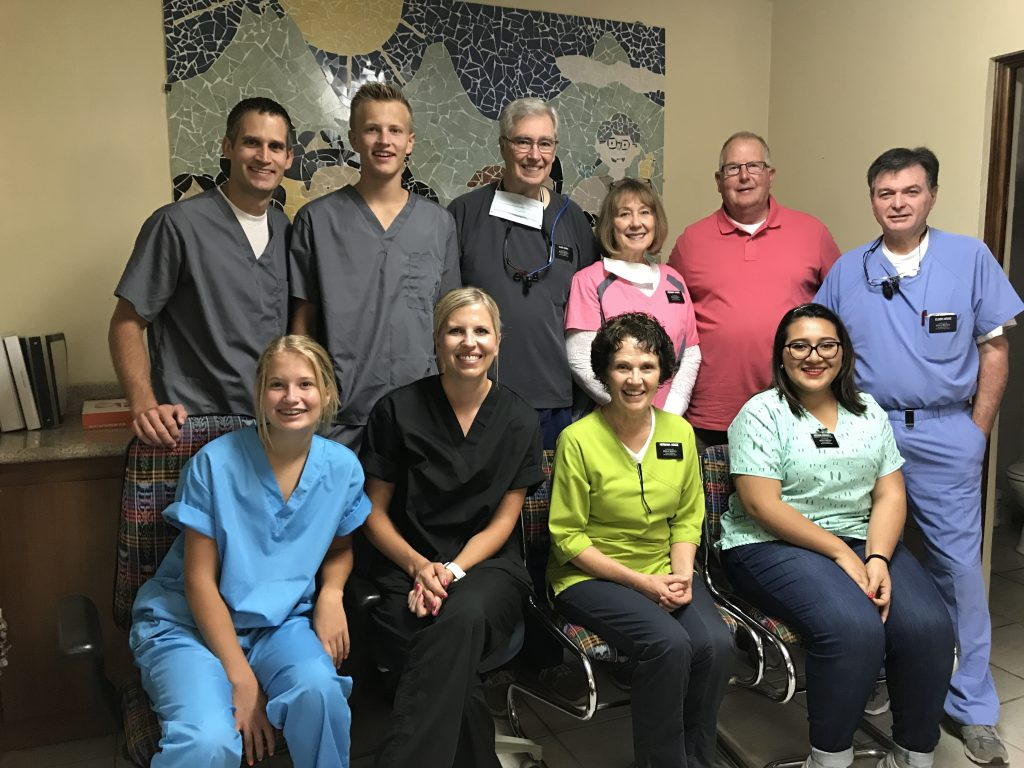 group photo of the entire dental team