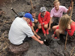 family roasting marshmallows on a volcano heat vent