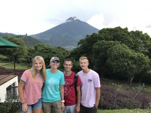 family photo in front of a volcano