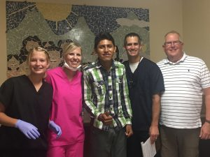 dental team standing with patient