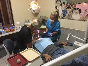 dentist and assistant working on patient