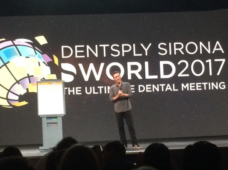 presentation showing a slide on Dentsply Sirona World 2017 and man presenting